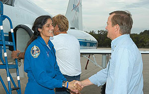 KSC-06PD-2632 -- Launch Director Mike Leinbach welcomes STS-116 Mission Specialist Sunita Williams
