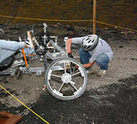 A team member works on the front of a moonbuggy