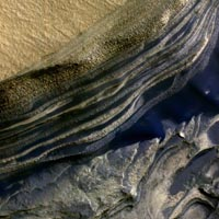 This false-color subframe of an image from the High Resolution Imaging Science Experiment camera on NASA's Mars Reconnaissance Orbiter shows the north polar layered deposits at top and darker materials at bottom. Image credit: NASA/JPL-Caltech/Univ. of Arizona
