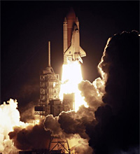 Space Shuttle Discovery launches on the STS-116 mission.
