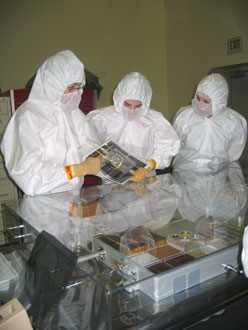 Photo of team in cleanroom