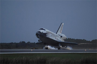 Discovery touches down at Kennedy Space Center's Runway 15, concluding the STS-116 mission.