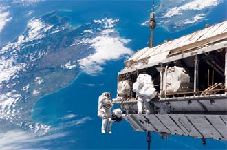 Mission Specialists Robert Curbeam and Christer Fuglesang participate in the mission's first spacewalk.