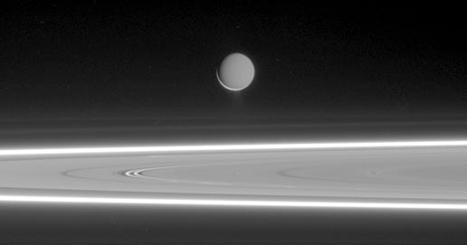 Enceladus above Saturn's rings