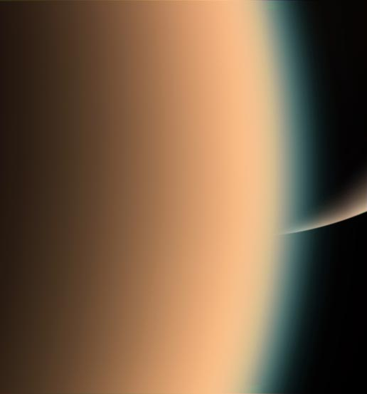 View of Titan with Saturn in the distance