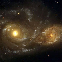 It could happen to us -- when the Milky Way and Andromeda galaxies meet in about 6 billion years. Hubble Space Telescope image of an encounter between the galaxies NGC 2207 and IC 2163. Strong tidal forces from NGC 2207 (left) have distorted the shape of the smaller galaxy.