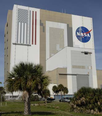 Painters work on the Vehicle Assembly Building.