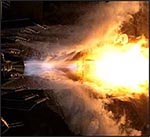 Flames escape from the nozzle of a rocket engine during testing