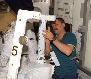 ISS014-E-12565 : Mikhail Tyurin with spacesuit