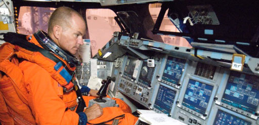 STS-117 Commander Rick Sturckow trains inside a shuttle simulator
