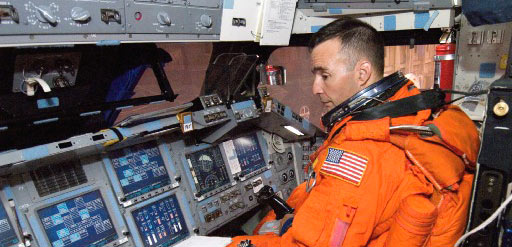 jsc2006e32653 -- STS-117 Pilot Lee Archambault trains in the shuttle simulator