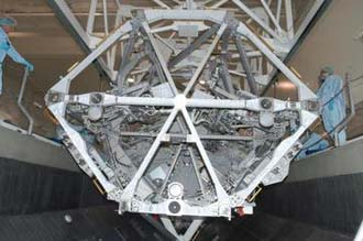 The S3/S4 integrated truss segment is loaded into the payload canister.
