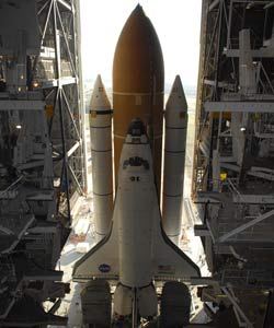 Space Shuttle Atlantis rolls out to Launch Pad 39A.