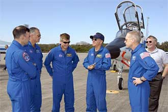 STS-117 crew members gather at the Shuttle Landing Facility.