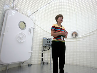Project lead Karen Whitley stands in the inflatable lunar habitat
