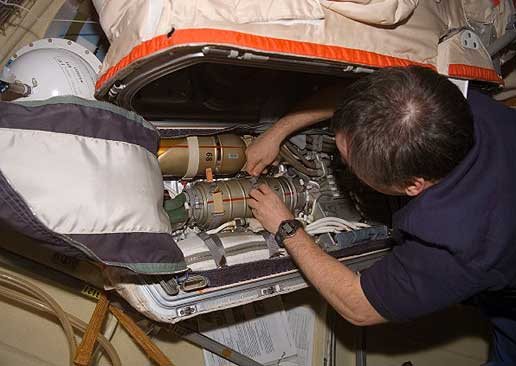 ISS014-E-13973 -- Tyurin Works With a Russian Orlan Spacesuit