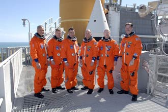 The STS-117 crew members gather atop Launch Pad 39A.