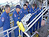 STS-117 astronauts take part in safety training at the launch pad.
