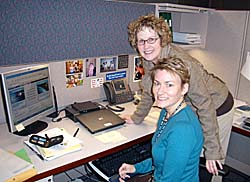 Peters and Burck at a desk
