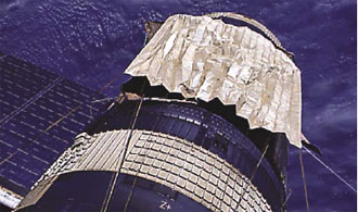 A reflective sunshield is installed during the Skylab-3 mission.