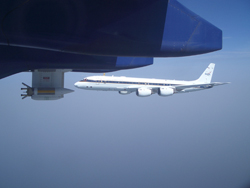 The NASA DC-8 aircraft flying with the BAe 146 aircraft off the coast of West Africa. The instrument mounted on the wing is a particle sensor that measures particle number density, concentration, condensed water content, precipitation rate, and other variables.