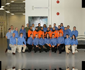 The STS-117 crew poses with the U.S. training team