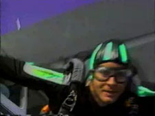 A close-up view of a skydiver jumping out of a plane