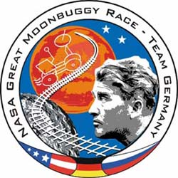 A mission patch depicts the face of Wernher von Braun; a moonbuggy; railroad tracks going from Earth to Mars via the moon; the flags of the United States, Germany and Russia; and the words NASA Great Moonbuggy Race Team Germany