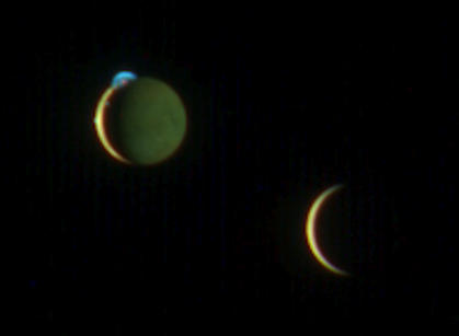 image of two moons over Jupiter
