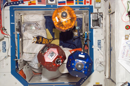 ISS014-E-17880 --- The three satellites of the SPHERES experiment.