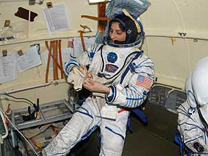 ISS014 -E-18743 -- Astronaut Sunita Williams dons her Russian Sokol launch and entry suit