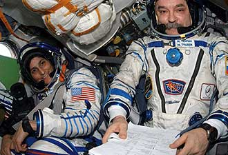 ISS014-E-18764 -- Astronaut Sunita Williams (left) and cosmonaut Mikhail Tyurin