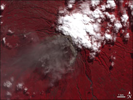 This image of the Merapi volcano on June 6, 2006 shows ground surface and vegetation as red underlying the volcanic plume and clouds.