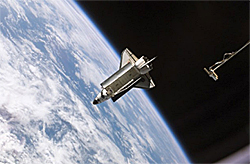 The space shuttle as photographed from the space station