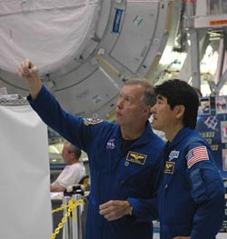 Astronauts Dominic Gorie and Takao Doi.