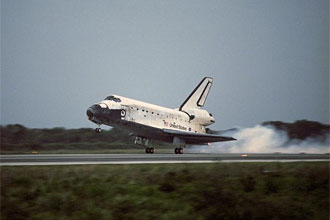 Discovery touches down on Kennedy Space Center's Runway 15, concluding STS-116.