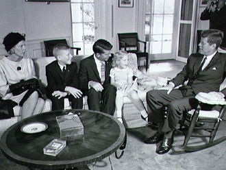 Walter Schirra, his wife and family visit with President John F. Kennedy.