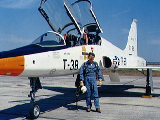 Walter Schirra standing next to his T-38 aircraft