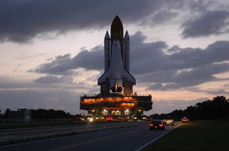 Shuttle Atlantis rides the crawler transporter to Launch Complex 39A.
