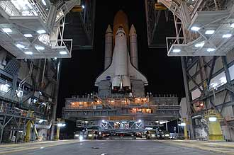 Shuttle Atlantis leaves the Vehicle Assembly Building.