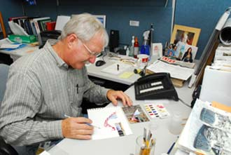 Ron Woods paints during his lunch break.
