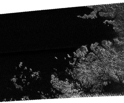 radar view of coastline and numerous island groups of a portion of a large sea on Titan