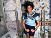 ISS015-E-08337 --- Sunita Williams wearing squat harness pads while using the Interim Resistive Exercise Device.