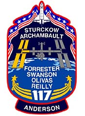The STS-117 patch features the names of the crewmembers and depictions of the shuttle and station