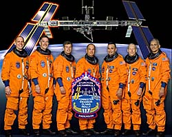 A portrait of the seven members of the STS-117 crew