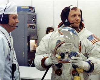Neil Armstrong gets his spacesuit on before heading to the launch pad for the Apollo 11 mission.