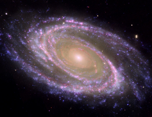 This beautiful galaxy is tilted at an oblique angle on to our line of sight, giving a 'birds-eye view' of the spiral structure.