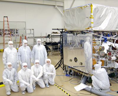NASA staffers in the General Dynamics clean room.