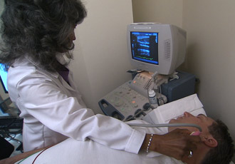 technician tests patient with carotid artery ultrasound