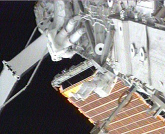 Mission Specialists Patrick Forrester and Steven Swanson check the Drive Lock Assembly 2 on the S3/S4 truss segment of the International Space Station